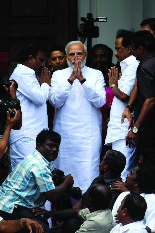 Prime Minister Narendra Modi (right) pays his last respects to Karunanidhi.