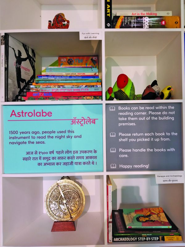 Artefacts, books and toys populate the shelves of the reading nook