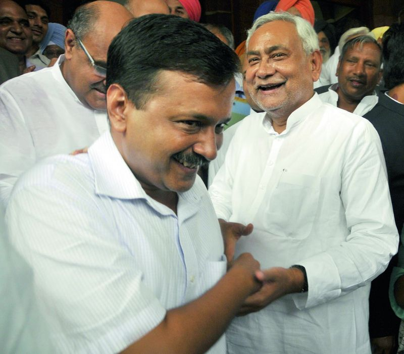 Delhi chief minister Arvind Kejriwal and Bihar chief minister Nitish Kumar at the swearing-in ceremony. (Photo: Pritam Bandyopadhyay)