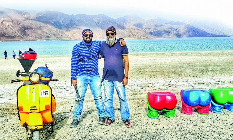 Akhil Rony and father Rony on the banks of Pangong Lake