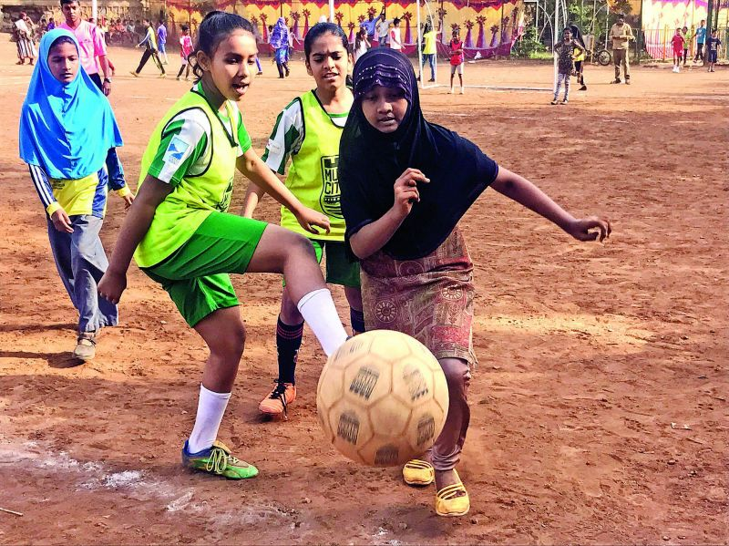 Girls in hijab playing football