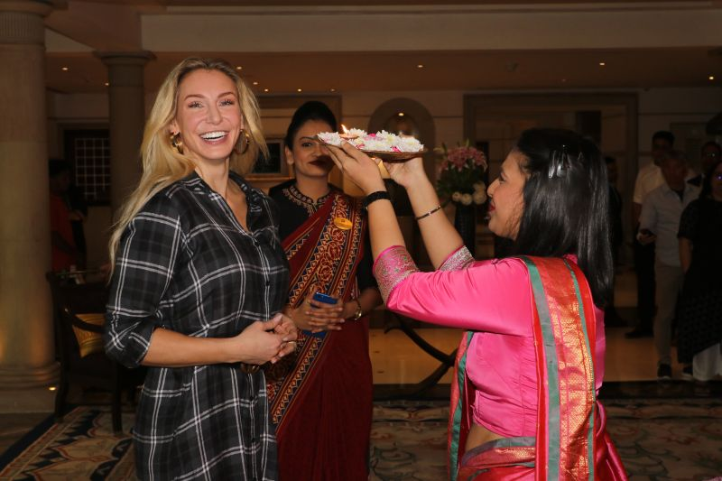 WWE Superstar Charlotte Flair is given the traditional Indian welcome as she arrives in Mumbai as part of her India tour.