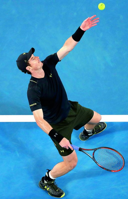 Britain's Andy Murray serves to Andrey Rublev of Russia in their Australian Open second round match on Wednesday. (Photo: AP)