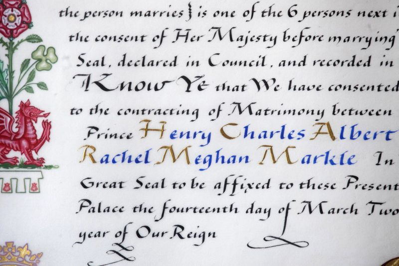 Bearing the names of Prince Harry and his fiancee Meghan Markle, the 'Instrument of Consent', which is the Queen's historic formal consent to Prince Harry's forthcoming marriage to Meghan Markle, photographed at Buckingham Palace in London, Friday May 11, 2018. Britain's Queen Elizabeth II signed, top right, the Instrument of Consent, her formal notice of approval for the wedding in elaborate calligraphic script issued under the Great Seal of the Realm. (Photo: AP)