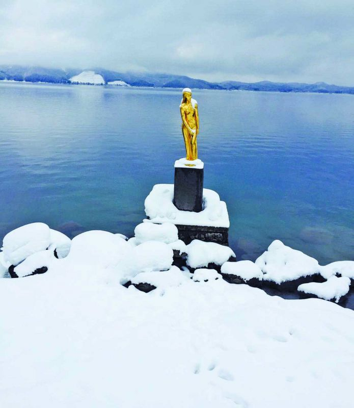 Golden statue in  Lake Tazawa