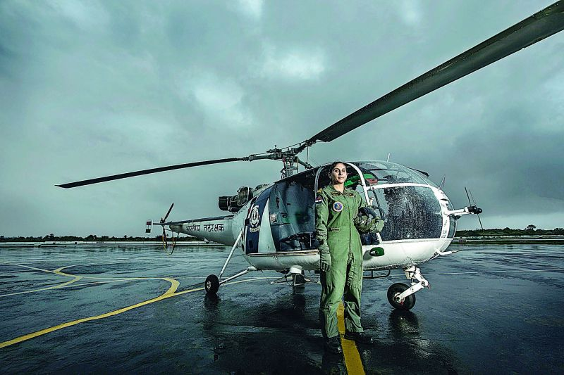 A pilot from the Indian Coast Guard ready to take off on a search and rescue mission