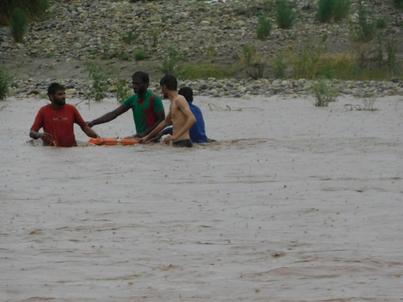 Six men who got trapped in the middle of the Tawi river near Pukroo. (Photo: ANI/Twitter)