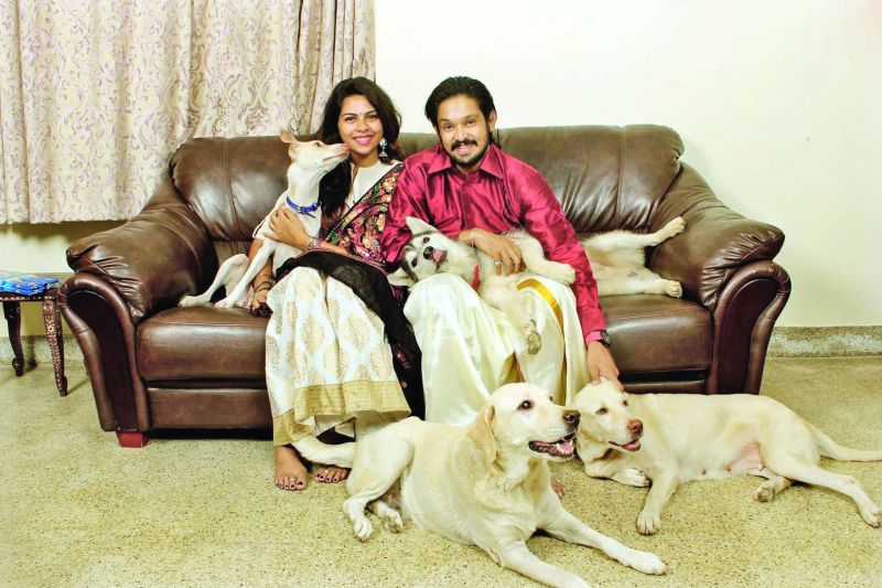 Sruthi and actor Nakul with their dogs