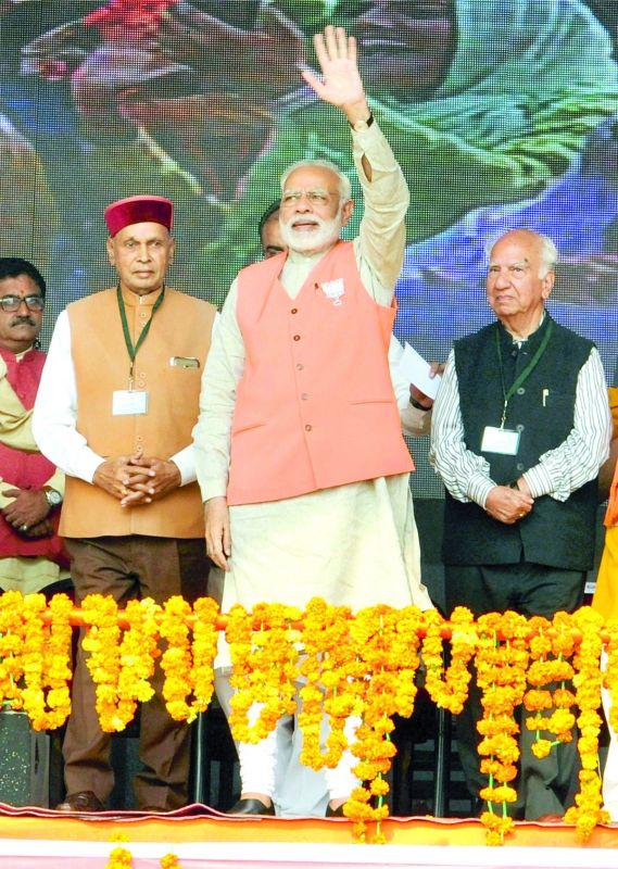 PM Narendra Modi, with CM candidate P.K. Dhumal and senior leader Shanta Kumar, at a rally in Kangra. (Photo: PTI)