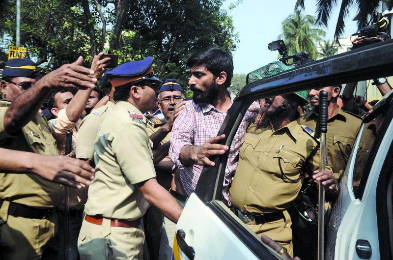 Pradip Narwal being taken away by the police upon detention. (Photo: Shripad Naik)