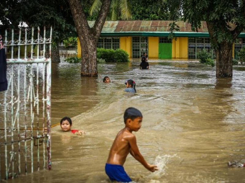 Residents wade through a flooded area in Kabacan, North Cotabato, on the southern island of Mindanao. (Photo: AFP)