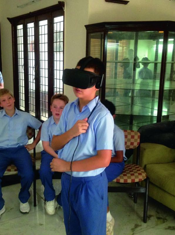 A school student  experiencing a VR class