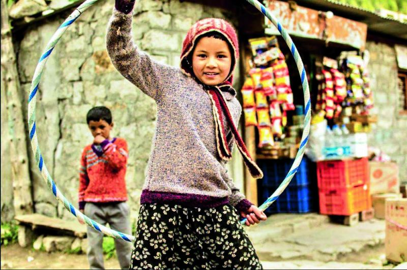 A young girl plays with a hula hoop in Chiku