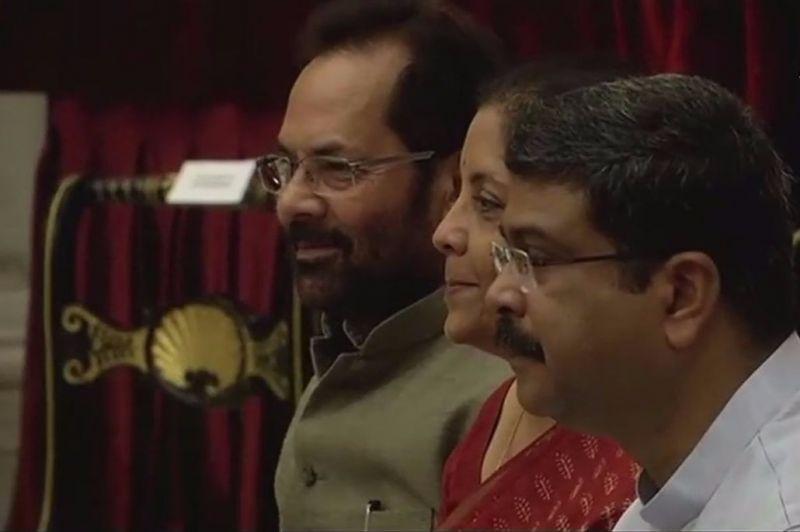 Union Ministers Mukhtar Abbas Naqvi, Nirmala Sitharaman and Dharmendra Pradhan. (Photo: ANI)