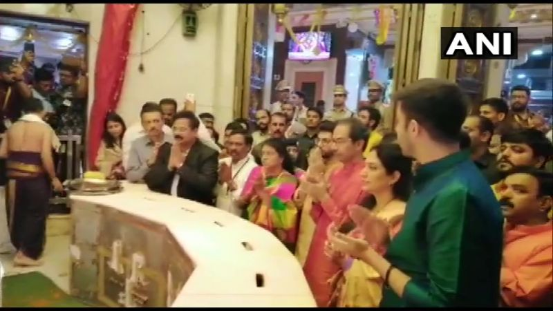 Maharashtra CM Uddhav Thackeray, along with his wife Rashmi and their son Aaditya Thackeray offer prayers at Siddhivinayak Temple. (Photo: twitter | ANI)