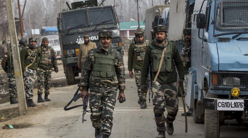 Indian Army and paramilitary soldiers patrol in Srinagar. (Photo: PTI)