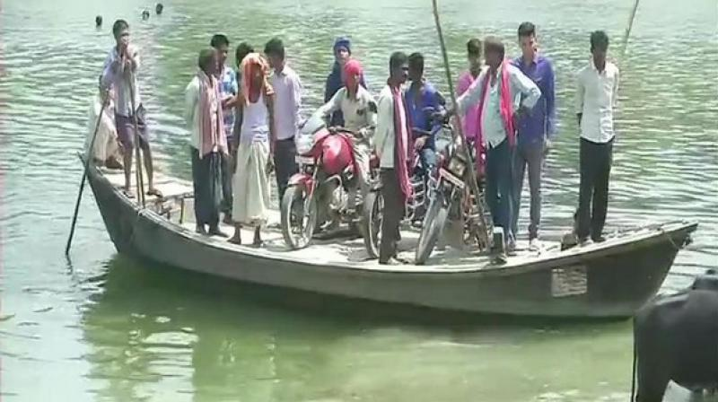 Surrounded by river Budhigandak on three sides, the village in Begusarai district has a single road which connects it to the rest of the state. (Photo: ANI)