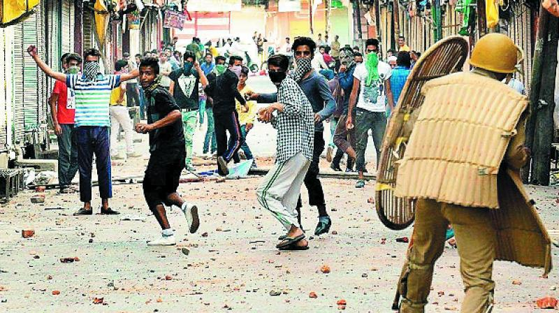 A file image of stone-pelters in Kashmir targeting CRPF personnel. (Representational Image)