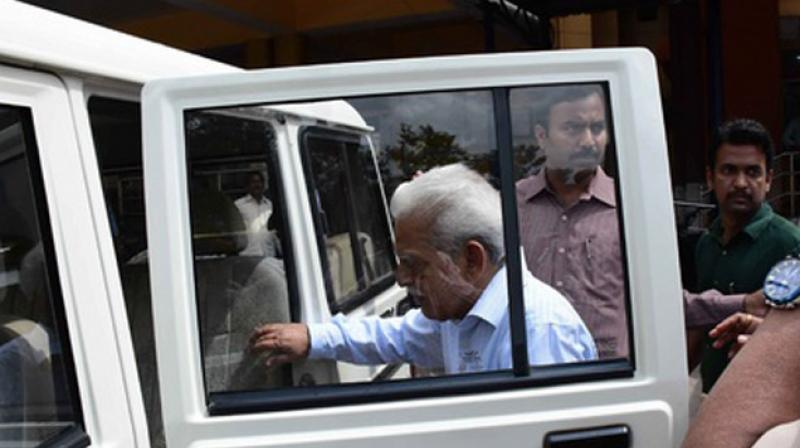 Indian poet and activist Varavara Rao enters a police vehicle after being arrested in Hyderabad. (Photo: AFP)
