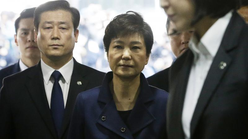 South Korea's ousted leader Park Geun-hye arrives at the Seoul Central District Court for hearing on a prosecutors' request for her arrest for corruption. (Photo: AP)