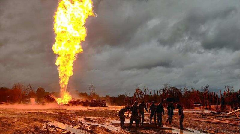 Picture of the raging fire at the oil well (PTI photo)