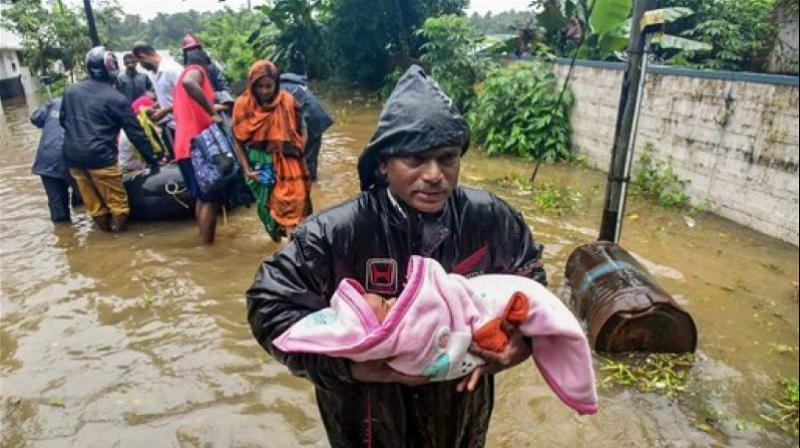 The flood situation in all 14 districts of Kerala, particularly in Pathanamthitta, remained grim on Thursday. At least 75 people have been killed so far. (Photo: PTI)