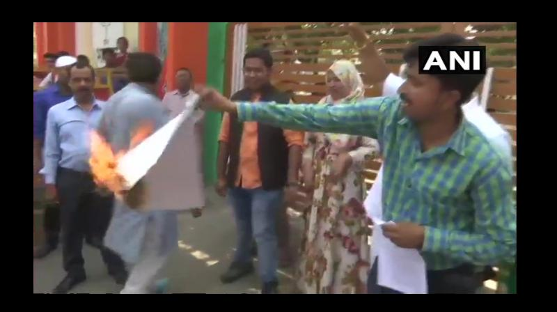 The controversy surrounding Jinnah's poster triggered after the BJP Aligarh MP Satish Gautam wrote a letter to AMU's vice-chancellor seeking an explanation on the portrait of Pakistan's founder in the students' union office. (Photo: ANI)