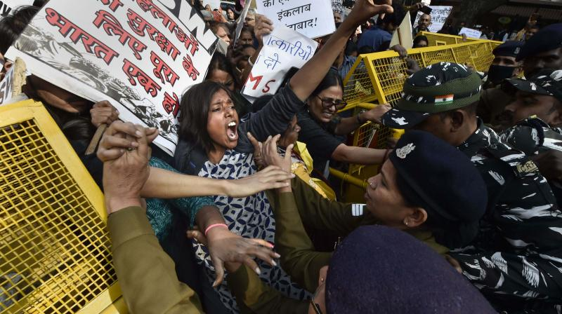 People stage a protest against Hyderabad rape and murder case in New Delhi on Monday. (Photo: PTI)