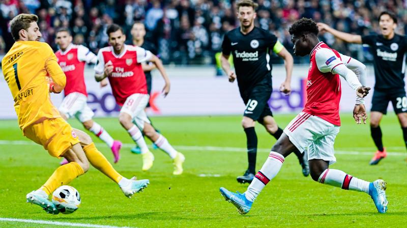 Tenage winger Bukayo Saka said it was a 'dream come true' to score his first goal for Arsenal in their 3-0 victory away to Eintracht Frankfurt in the Europa League. (Photo:AFP)