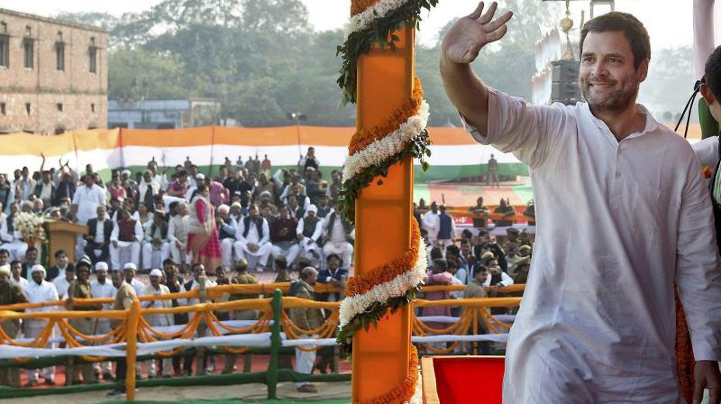 Congress Vice-President Rahul Gandhi gestures to the crowd during the 'Jan Akrosh rally', in Jaunpur. (Photo: PTI)