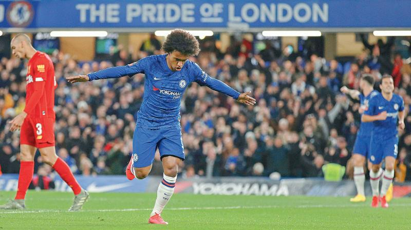 Chelsea's Willian celebrates after scoring against Liverpool in the English FA Cup. AP Photo