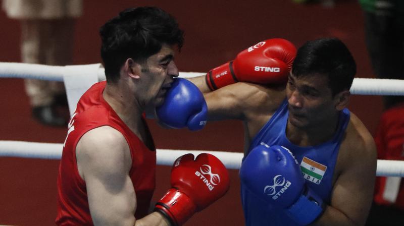 CLOSE-IN ON: Indian's Gaurav Chauhan (R) punches Pakistan's Sanaullah during their South Asian Games (SAG) bout in Kathmandu, Nepal. AP Photo