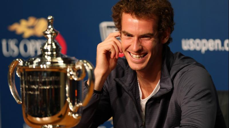 Andy Murray with the first of his three Grand Slam trophies, the US Open he won in 2012. AFP Photo