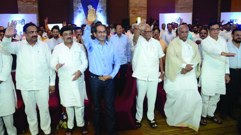 NCP chief Sharad Pawar, Shiv Sena chief Uddhav Thackeray and Congress leader Mallikarjun Kharge along with party MLAs take a pledge not to be lured by the BJP at Mumbai's Grand Hyatt Hotel on Monday.  (Photo: Rajesh Jadhav)