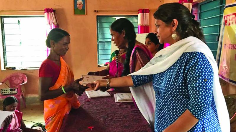 Archana Kapoor of SMART with women at one of the centres.