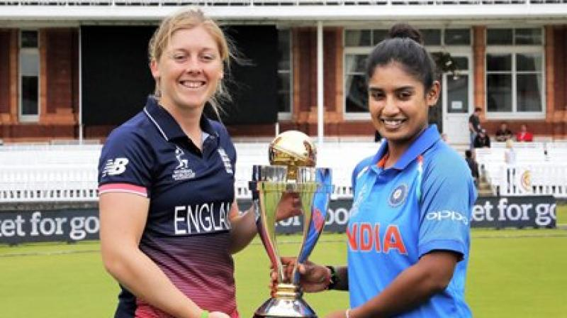 Rival captains Heather Knight (left) and Mithali Raj pose with the World Cup at Lord's on Saturday. (Photo: PTI)