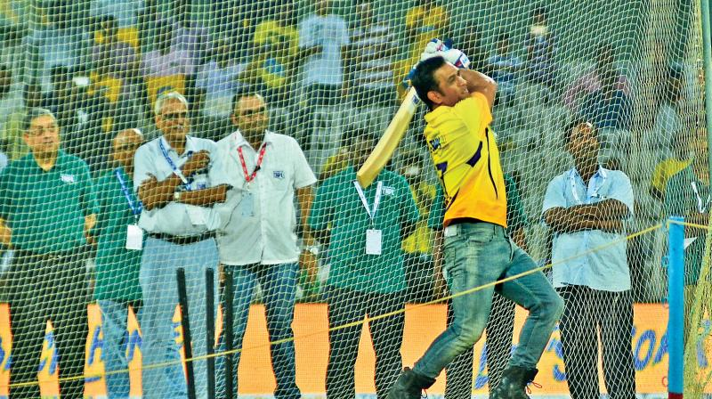M.S. Dhoni, sporting a yellow jersey, takes part in the 'six-hitting' competition that kick-started the second edition of the Tamil Nadu Premier League on Saturday. Former BCCI president N. Srinivasan looks on from behind. (Photo: E.K. Sanjay)