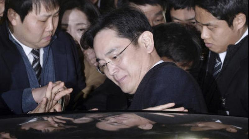 Lee Jae-yong, vice chairman of Samsung Electronics Co., gets into a car to leave after attending a hearing at the Seoul Central District Court in Seoul, South Korea. (Photo: AP)