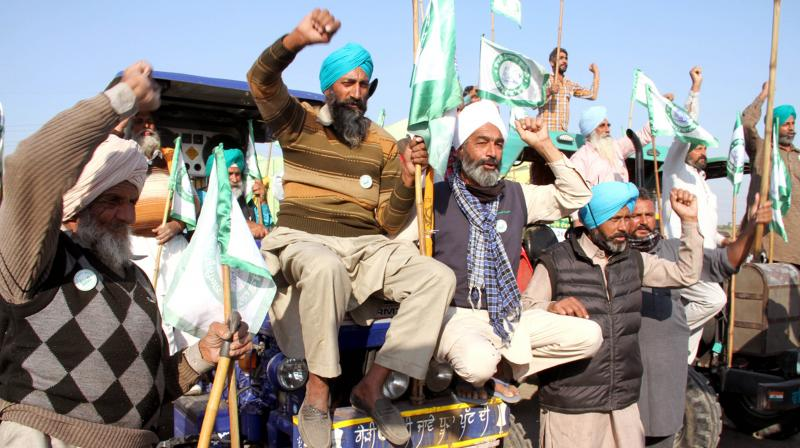 Farmers who came from Punjab and Haryana to protest against the new Farmers Law reached at Burari ground raising slogans to withdraw the anti-farmers law, in New Delhi. (DC Image:D. Kamraj)