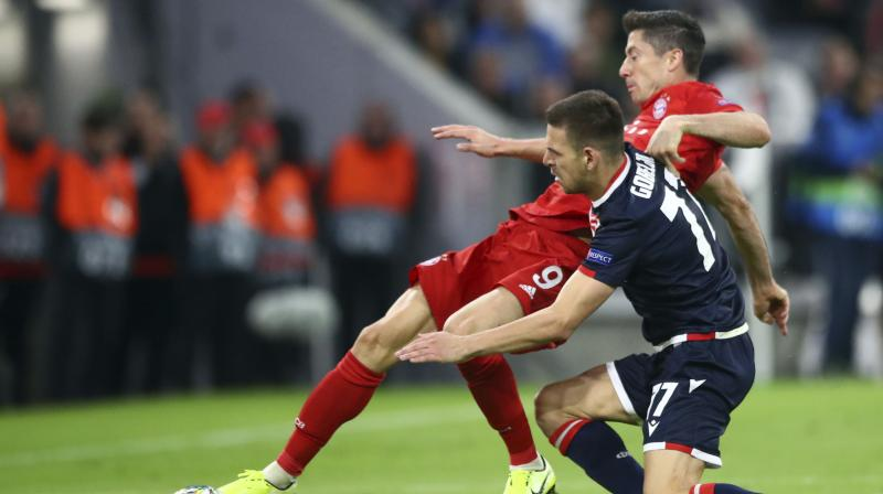 Bayern Munich's Robert Lewandowski scored a landmark 200th goal for the club as they kicked off their Champions League campaign by easing to a 3-0 victory over Red Star Belgrade on Wednesday in a one-sided Group B encounter. (Photo:AP)