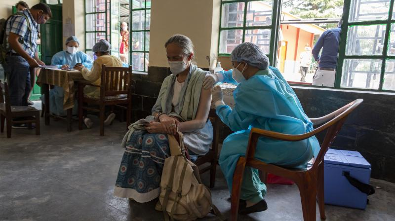 Valerie Marie Jeanne, a French national, gets her second dose of a COVID-19 vaccine in Dharmsala. (Photo: AP)