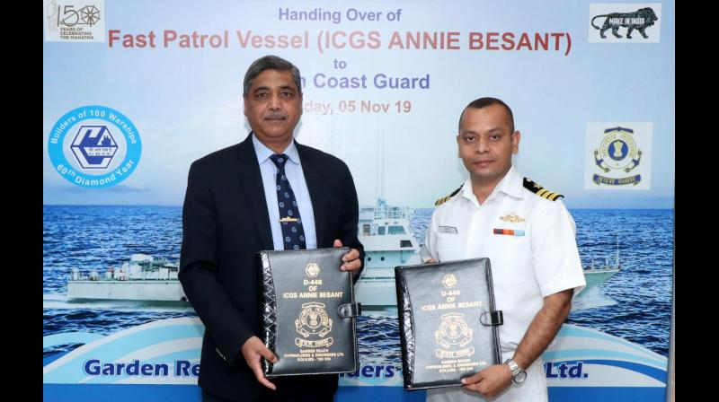 GRSE chairman & managing director Rear Admiral V K Saxena (on left) and Commanding Officer of Annie Besant: Commandant (JG) Sunny Deo of the Indian Coast Guard at the protocol of delivery and acceptance on Tuesday.