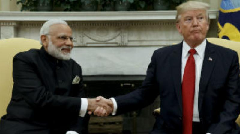 US President Donald Trump will attend the World Economic Forum in Davos later this month, opening up a distinct possibility of a meeting with Prime Minister Narendra Modi. (Photo: PTI/File)