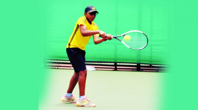 Pune boy and Under 12 national champion Manas Dhamne moved into the second round with ease accounting for Sudhanshu Sawant 6-0, 6-2.