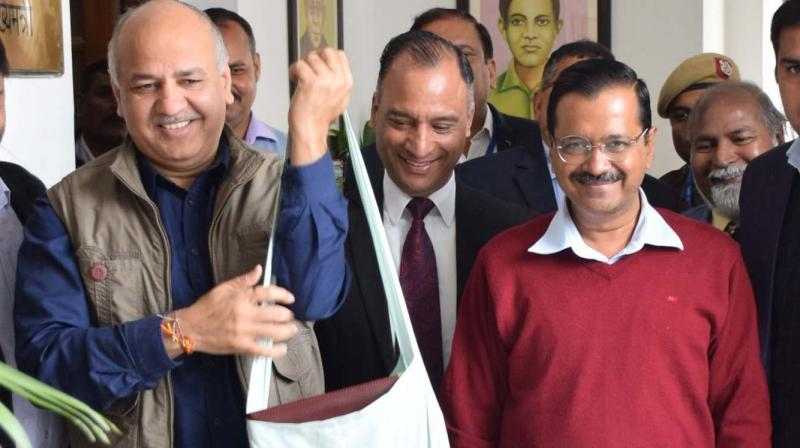 Delhi Dy CM Manish Sisodia, who also holds the finance portfolio, with CM Arvind Kejriwal before presenting the Budget on Tuesday. (Photo: Bunny Smith)