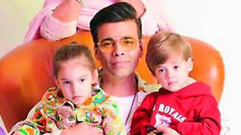 Karan Johar with his kids Yash and Roohi