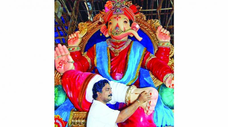 Vijay Khatu putting final touches on an idol
