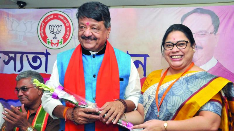 Union minister of state for women and child development and BJP leader Debasree Chaudhuri welcomes party national general secretary Kailash Vijayvargiya during a partys membership drive programme in Kolkata on Sunday. (Photo: PTI)