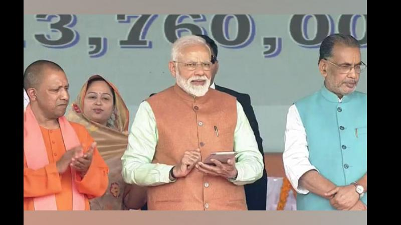 After launching the scheme, the Prime Minister also handed over certificates to select beneficiaries of the scheme. (Photo: ANI)