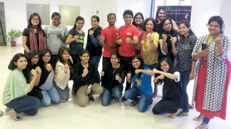 A file picture of girls at a martial arts class with trainer Prasad.